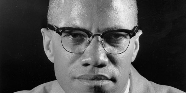 "FILE - In this file photo of March 5, 1964, Malcolm X is seen during an interview in New York. A never-published introduction to his best-selling autobiography was read publicly for the first time on Wednesday, May 19, 2010. ""The Autobiography of Malcolm X,"" written with co-author Alex Haley, was released shortly after the civil rights leader was assassinated. The existence of the introduction, and three other unpublished chapters were known of since attorney Gregory J. Reed bought them at a 1992 auction of Haley's estate. (AP Photo/Eddie Adams, File)"
