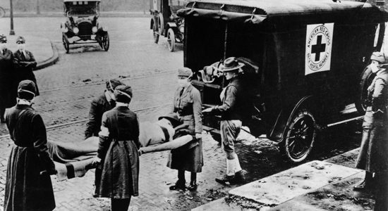 1919: American Red Cross volunteers carry a Spanish flu victim, 1919. It is estimated that anywhere from 20 to 100 million people were killed worldwide, or the approximate equivalent of one third of the population of Europe, more than double the number killed in World War I.